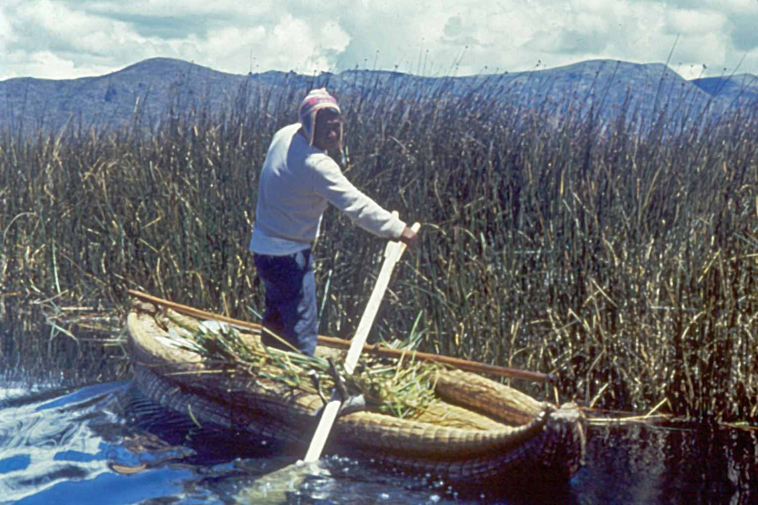 Peru - Page 2 Uros_Indian_in_a_reed_boat_Lake_Titicaca_Peru_low_res_copy