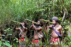 Huli men drinkin magic water Papua New Guinea