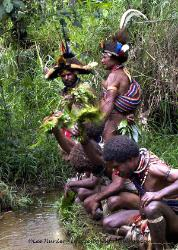 Huli men watering their hair Papua New Guinea