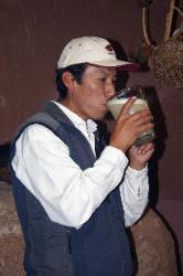 Drinking Chicha (corn) beer, village of Urubamba, Andes Mts