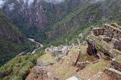 Ruins at Machu Picchu, with the Urubamba river below, Peru