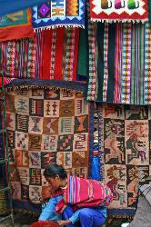 Textiles for sale, outdoor market at Pisac, Andes Mts, Peru