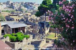 The ruins of ancient Herculaneum, with the modern town above, Italy