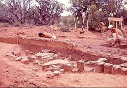 Archaeologists excavating a Basketmaker pithouse, Cedar Mesa, Utah